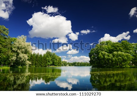 Lake in city park with trees. Beautiful summer landscape - stock photo