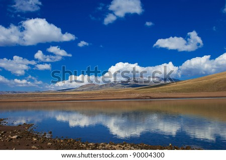 Lake in mountains with beautiful skies - stock photo