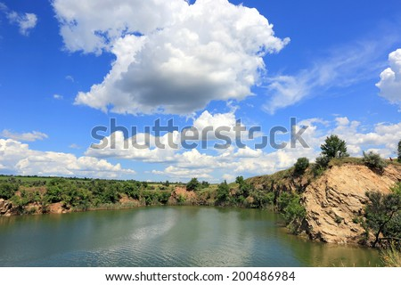 lake in old opencast mine place in summer day  - stock photo