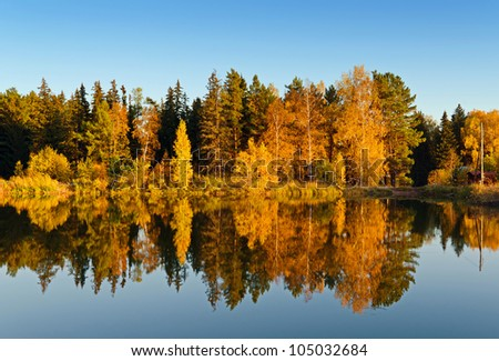 Lake in sunset rays. Fall landscape. - stock photo