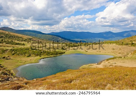 Lake in the Carpathian Mountains in autumn. Ukraine - stock photo