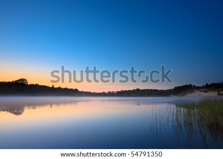 Lake in the mist at sunset, National Park Zuid Kennemerland, The Netherlands