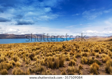 lake in the mountains on a cloudy day - stock photo