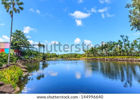 lake in the park with reflection of white cloud and blue sky in the water