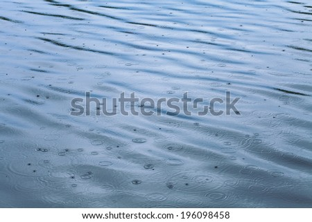 Lake in the rain - stock photo