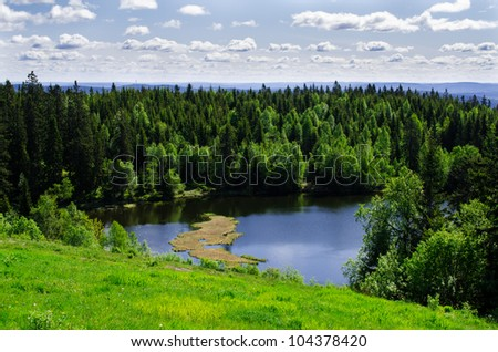 Lake in the spring forest Oslo, Norway - stock photo