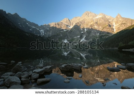 Lake in the Tatra Mountains at dawn. - stock photo