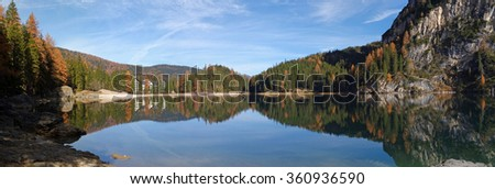 Lake in the tyrolean alps in autumn with a wooden hut