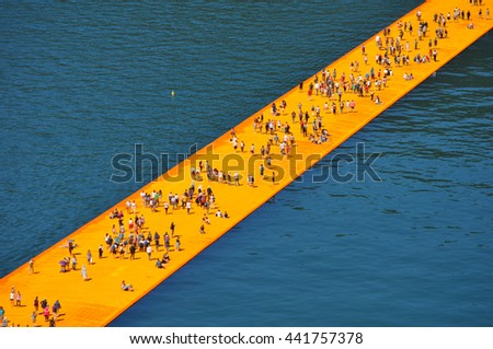 LAKE ISEO, ITALY - CIRCA JUNE 2016: The Floating Piers site specific artwork by Christo and Jeanne Claude