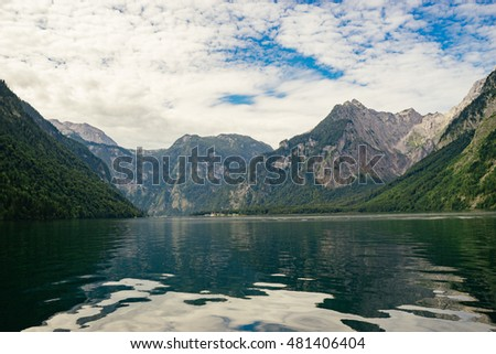 Lake Konigssee against scenic cloudscape,  Berchtesgadener Land, Bavaria, Germany
