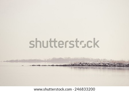 Lake landscape a quiet winter morning - stock photo