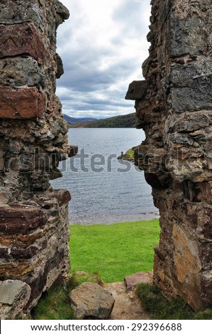 Lake landscape from a window view of ruined castle, Scotland - stock photo