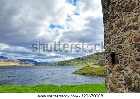 Lake landscape from view of ruined castle, Scotland - stock photo