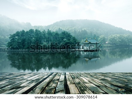 lake landscape in lushan,blue sky and the pavilion reflected in the water - stock photo