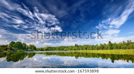 Lake landscape with beautiful reflection of a sky - stock photo