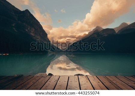 Lake Louise after rain at sunset with cloud and reflection - stock photo