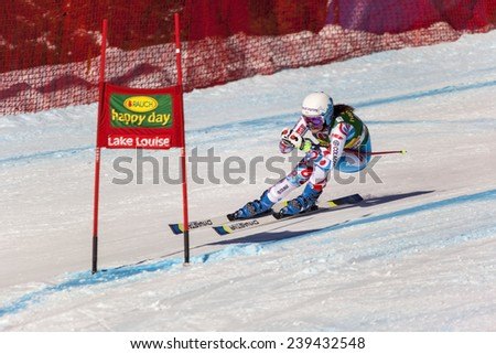 LAKE LOUISE, ALBERTA CANADA - DEC.7.2014. : 55 official entry speeds down the course  during the Audi FIS Alpine Ski World Cup Ladies' Super G race. The average speed is 114 km/h during the race.      - stock photo