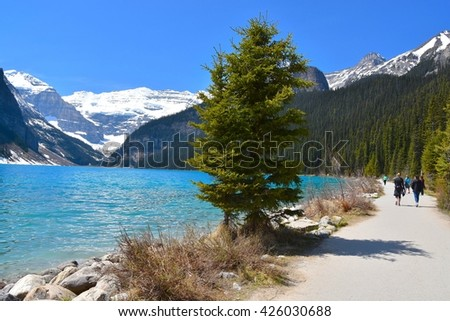 LAKE LOUISE, ALBERTA - MAY 16 - Lake Louise in Alberta, Canada on May 16, 2016. The beautiful Lake Louise is visited by millions of people every year. - stock photo