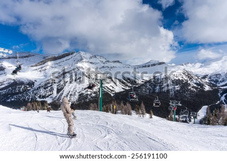 LAKE LOUISE, CANADA - FEBRUARY 14: Skiers descend the slopes at Lake Louise Feb. 14, 2015. Lake Louise is a popular ski resort in Banff National Park, Canada. - stock photo