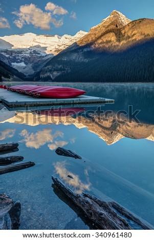 Lake Louise Canoes in Banff National Park at sunrise - stock photo