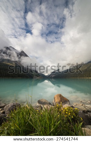 Lake Louise in Banff National Park, Alberta, Canada on a cloudy morning (vertical) - stock photo