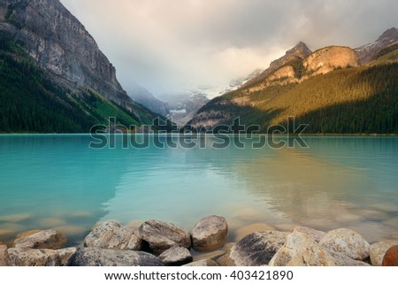 Lake Louise in Banff national park with mountains and forest in Canada. - stock photo