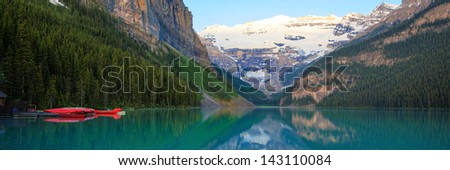 Lake Louise with a red canoe, Banff National Park, Canada - stock photo
