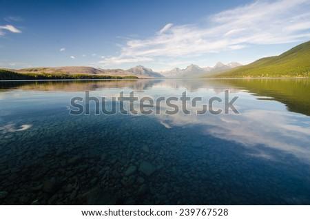 Lake MacDonald at Glacier National Park just before sunrise. - stock photo