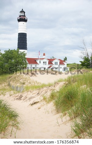Lake Michigan Lighthouse Ludington Big Sable Lighthouse on the shore of Lake Michigan. Sand dunes in foreground. - stock photo
