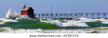 Lake Michigan showing all her fury with waves pounding against the beach in Grand Haven Michigan during a wind storm. - stock photo