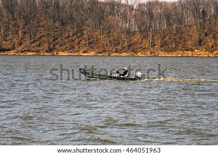 Lake Monroe, Indiana, USA, March 29, 2016: Fishman floats on a motor boat on the river, Lake Monroe, Indiana