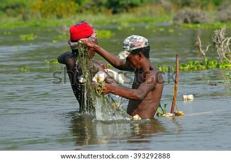 LAKE NAIVASHA - FEBRUARY 21 : Fishermen at 21 February 2016 in Lake Naivasha, Kenya. Fishing is the main source of food for the locals in the central part of Kenya. - stock photo