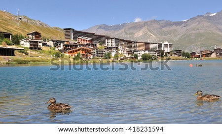 lake  of Tignes in summer with ducks - stock photo