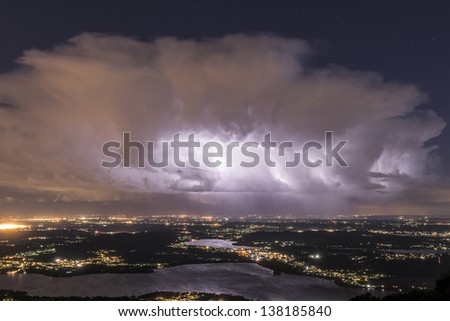 Lake of Varese in the night and thunderstorm at the horizon