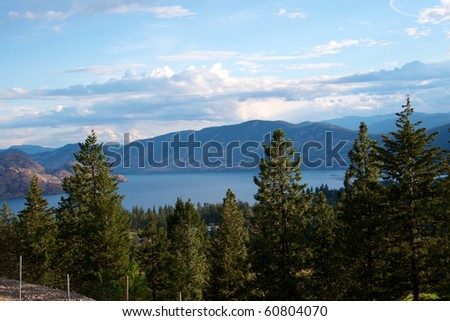Lake Okanagan set among mountains and forests in British Columbia Canada - stock photo