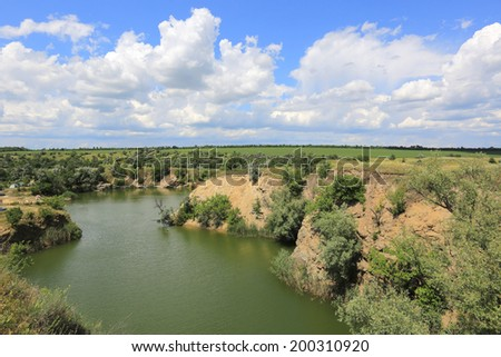 lake on old flooded opencast mine place in summer day  - stock photo