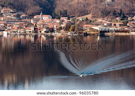 Lake Orta famous landscape with a boat passing by