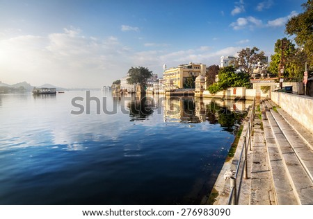 Lake Pichola and hotels at blue sky in Udaipur, Rajasthan, India - stock photo