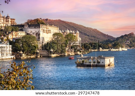 Lake Pichola with City Palace view at pink sunset sky in Udaipur, Rajasthan, India - stock photo
