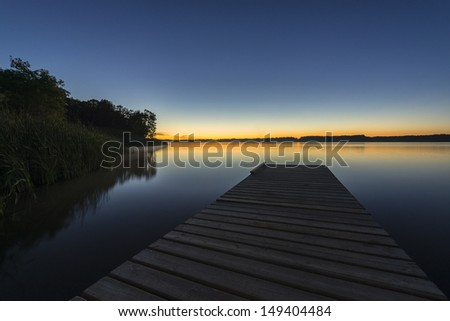Lake Pier At Night - stock photo