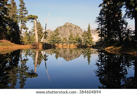Lake reflection of Mount Hanover in Cypress Provincial Park, British Columbia, Canada. - stock photo
