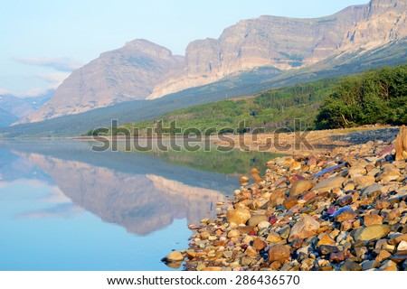 Lake reflections in Glacier National Park. - stock photo