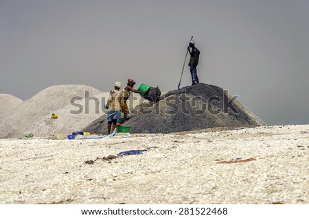 Lake Retba, Senegal - 09/10/2013. Women work on the extraction of salt - stock photo