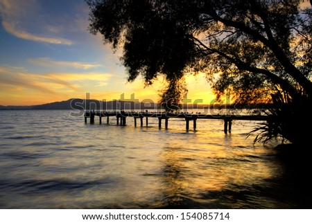 Lake Rotorua at Sunset from Hamurana side, looking towards Mount Ngongotaha. Rotorua, North Island, New Zealand  - stock photo