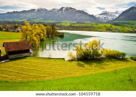 Lake Sarner on the Background of Snow-capped Alps, Switzerland - stock photo