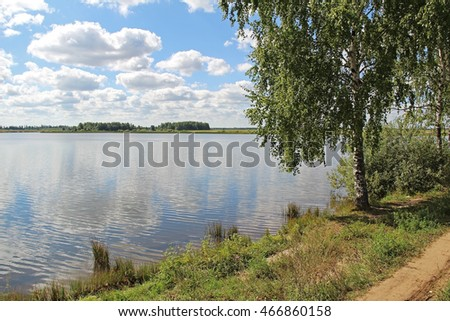 Lake shore and a beautiful cloudscape in summer. Russia.
