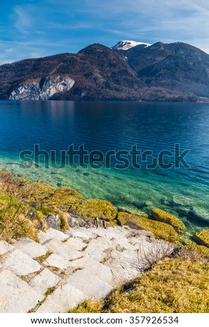 Lake Shore And Stairs Into Turquoise Wolfgang Lake With Grosser Hollkogel In The Background-Salzkammergut, Austria,Europe - stock photo