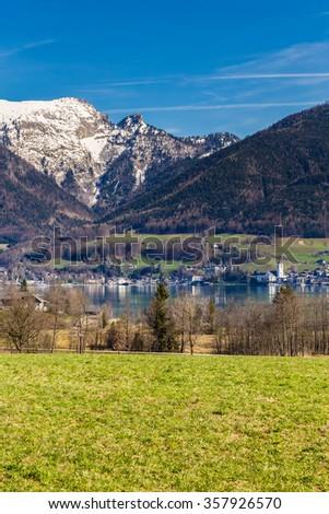 Lake Shore Of Wolfgang Lake With St. Wolfgang Im Salzkammergut And Grosser Hollkogel In The Background-Salzkammergut, Austria,Europe - stock photo