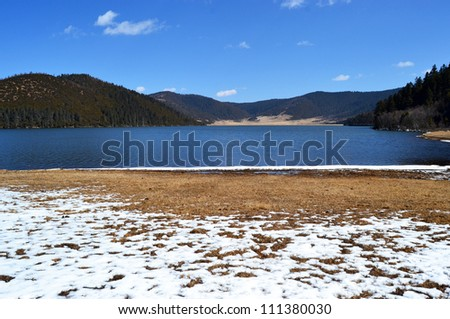Lake Shudu, the blue lake with mountain in western china in pudacuo national park, Shangri-la county, Yunnan province, China - stock photo