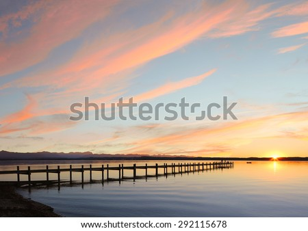 lake starnberg and mountain range, sunset sky background with copy space - stock photo